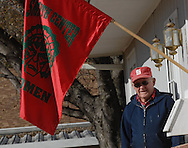 11/7/07 Smith Center, KS.Paul Pletcher with a flag showing his support of the Smith Center Redmen football team..Pletcher has two grandson's on the team Cody  and Van Tucker...(Chris Machian/Prairie Pixel Group)