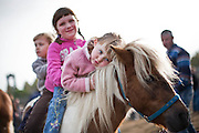 Three year old Ella Wakefield,Birr ,Co Offaly with her sisters Jackie and Erin on their Shetland Pony at Ballinasloe Horsefair.