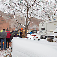 Balloon crews stand near a fire on Friday morning, as the Mass Ascension of the 38th annual Red Rock Balloon Rally was canceled due to weather at Red Rocks Park.