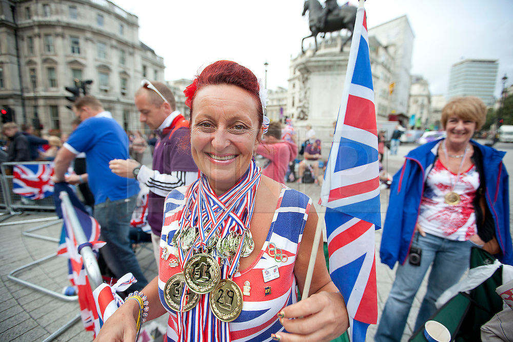 © Licensed to London News Pictures. 10/09/2012. LONDON, UK. Fans of the London 2012 Olympic and Paralympic Games prepare for the Great Britain team parade to take place in Trafalgar square, London, today (10/09/12). Photo credit: Matt Cetti-Roberts/LNP