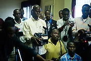 Liberian journalists attend a press conference in Central Monrovia to observe the display of a cache of weapons discovered at the Liberia-Cote d'Ivoire border. Chris Massaquoi, commissioner of the Bureau of Immigration and Naturalization, turned the arms cache over to Mrs. Rose E. Stryker, deputy director of police for Administration. The discovery follows another of larger proportion only two months earlier, when similar weapons and ammunition were found, resulting in numerous arrests.