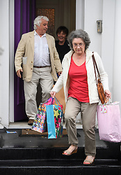 © Licensed to London News Pictures. 01/06/2016. London, UK. COLIN and ALISON HUMPHREYS, the father-in-law and mother-in-law of Ronnie Wood, leave the Rolling Stone guitarist's London home holding gifts, two days after Ronnie Wood and his wife Sally Humphreys had twins. Ronnie Wood also turned 69 today (weds).  Photo credit: Ben Cawthra/LNP