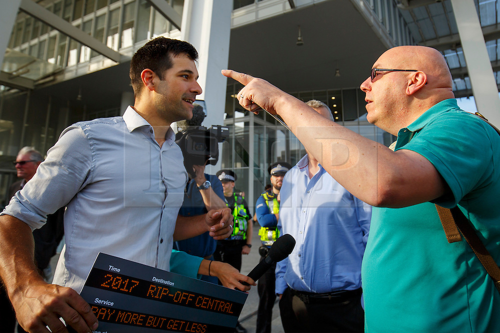 © Licensed to London News Pictures. 16/08/2016. London, UK. A man argues with members of rail unions campaigning outside London Bridge Station in London on Tuesday, 16 August 2016. Photo credit: Tolga Akmen/LNP