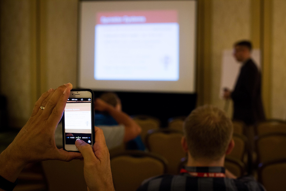 A member of the Tau Kappa Epsilon takes a photo with his phone during a workshop at New Orleans Marriott on maintenance, safety, and insurance of TKE houses on college campuses during the fraternity's 58th Biennial Conclave of the Tau Kappa Epsilon fraternity in New Orleans, La. Photo by Kevin Liles/kevindliles.com