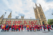 A large message during speeches at Old Palace Yard which included the rallying cry 'Make June the end of May' - Trump & May Climate Disaster protest in support of the US climate march today. As Trump reaches his first 100 days and pushes to slash the US climate research budget. In the UK the government has been reducing budgets and appears to be veering away from Climate Act commitments by forcing through a 3rd runway at Heathrow.