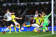 A scramble in the box results in a clearance during the EFL Sky Bet Championship match between Derby County and Blackburn Rovers at the Pride Park, Derby, England on 18 September 2018.