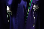 "Penintents of ""Nuestra Señora de la Esperanza"" brotherhood praying. General Procession of Good Friday considered<br /> Cultural Heritage of Mataró city (Barcelona, Spain) since 2013.  Easter 2015. Eva Parey/4SEE"