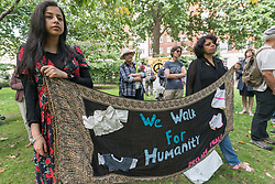 August 6, 2017 - London, UK - London, UK. 6th August 2017. Women hold a banner 'We Walk for Humanity' at the London CND ceremony in memory of the victims, past and present on the 72nd anniversary of the dropping of the atomic bomb on Hiroshima and the second atomic bomb dropped on Nagasaki three days later. After a number of speeches and performances there was a minute's silence during which the Deputy Mayor of Camden and others laid flowers around the commemorative cherry tree. Peter Marshall ImagesLive (Credit Image: © Peter Marshall/ImagesLive via ZUMA Wire)