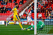 Wimbledon midfielder Anthony Wordsworth (40) is beaten to the ball by Doncaster Rovers goalkeeper Ian Lawlor (1)  during the EFL Sky Bet League 1 match between Doncaster Rovers and AFC Wimbledon at the Keepmoat Stadium, Doncaster, England on 17 November 2018.