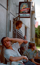 """CZECH REPUBLIC BOHEMIA LIBESTICE JUL97 - Three adolescents recover from a heavy hangover after a tough weekend of drinking, locally called a 'majdan'. The sign in the background reads: """"Beer Sanatorium"""".  ..jre/Photo by Jiri Rezac. . © Jiri Rezac 1997. . Tel:   +44 (0) 7050 110 417. Email: jiri@jirirezac.com. Web:   www.jirirezac.com"""