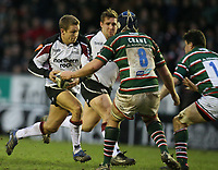Photo: Rich Eaton.<br /> <br /> Leicester Tigers v Newcastle Falcons. Guinness Premiership. 27/01/2007. Jonny Wilkinson of Newcastle Falcons charges at Jordan Crane of Tigers