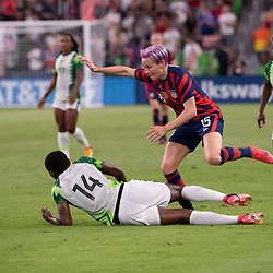 USA's MEGAN RAPINOE (15) tries to go over a fallen CHIDINMA OKEKE (14) of Nigeria  as the US Women's National Team (USWNT) beats Nigeria, 2-0 in the inaugural match of Austin's new Q2 Stadium. The U.S. women's team, an Olympic favorite, is wrapping up a series of summer matches to prep for the Tokyo Games.