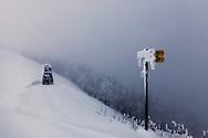 Deep snow and fog on a mountain ridge