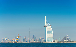 Skyline of Dubai waterfront with Burj al Arab Hotel in United Arab Emirates