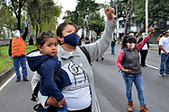Persons lift their hands during a the minute of silence  in memory of the victims who lost their lives in the earthquake of 2017 at Tlalpan Multifamily amid coronavirus pandemic. (Photo by Carlos Tischler/Speed Media)