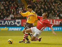 Photo: Glyn Thomas.<br />Charlton Athletic v Arsenal. The Barclays Premiership.<br />26/12/2005.<br />Charlton's Danny Murphy (R) slides in to challenge Cesc Fabregas.