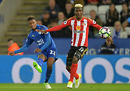 Demarai Gray of Leicester city takes a shot on goal as Didier N'Dong of Sunderland tries to block it . Premier league match, Leicester City v Sunderland at the King Power Stadium in Leicester, Leicestershire on Tuesday 4th April 2017.<br /> pic by Bradley Collyer, Andrew Orchard sports photography.