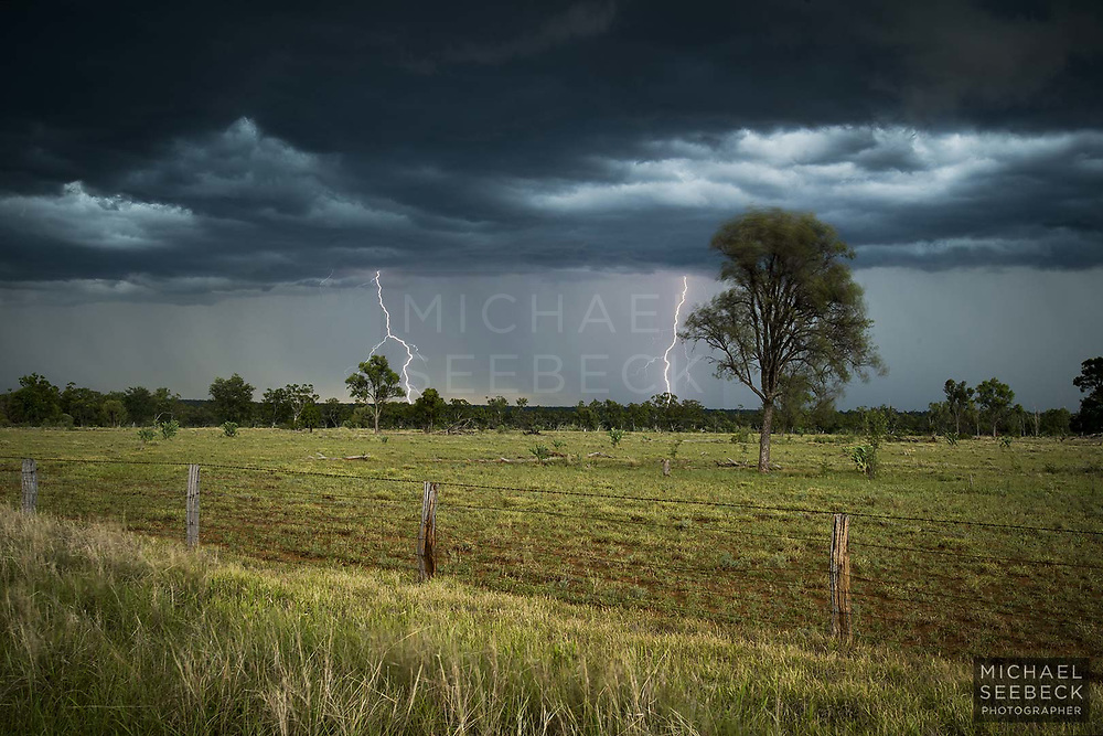 A violent thunderstorm advances over the plains of the western Darling Downs, as lightning strikes the ground.<br /> <br /> Code: LAQS0010<br /> <br /> Open Edition Print / Stock Image