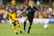 Rosie White gets through the defence of Teresa Polias during the Cup of Nations Women's Football match, New Zealand Football Ferns v Matildas, Leichhardt Oval, Thursday 28th Feb 2019. Copyright Photo: David Neilson / www.photosport.nz