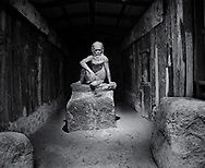 William Rickets Sanctuary - Black and white photo art print of Sculpture of an Aboriginal man in the deep woodland of the Dandenon Mountain near Melbourne Australia. Taken 1993 by Paul Williams,