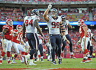 KANSAS CITY, MO - OCTOBER 20:  Defensive end J.J. Watt #99 of the Houston Texans reacts after sacking quarterback Alex Smith #11 of the Kansas City Chiefs during the second half on October 20, 2013 at Arrowhead Stadium in Kansas City, Missouri.  (Photo by Peter G. Aiken/Getty Images) *** Local Caption *** J.J. Watt;Alex Smith