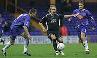 Photo: Dave Howarth.<br />Stockport County v Swansea City. The FA Cup.<br />05/11/2005.  Swansea's Paul Connor races past Stockport's Ross Greenwood and Keith Briggs