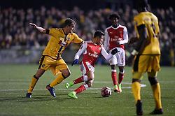 Sutton United's Jamie Collins (left) and Arsenal's Alexis Sanchez battle for the ball
