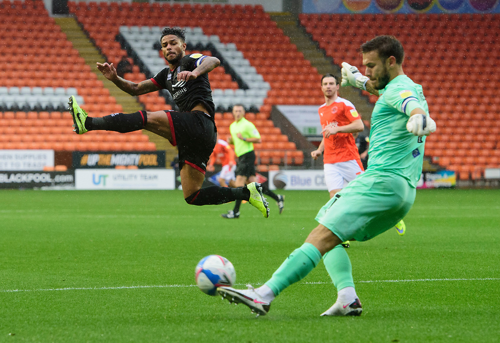 Blackpool's Chris Maxwell clears under pressure from Lincoln City's Liam Bridcutt<br /> <br /> Photographer Chris Vaughan/CameraSport<br /> <br /> The EFL Sky Bet League One - Blackpool v Lincoln City - Saturday 3rd October 2020 - Bloomfield Road - Blackpool<br /> <br /> World Copyright © 2020 CameraSport. All rights reserved. 43 Linden Ave. Countesthorpe. Leicester. England. LE8 5PG - Tel: +44 (0) 116 277 4147 - admin@camerasport.com - www.camerasport.com