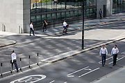 Pedestrians cross London Wall, the site of the original Roman walled boundary of their Londinium settlement - now known as the City of London, the capitals financial district, on 21st August 2018, in London, England.