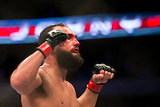 Johny Hendricks celebrates after the fifth round against Robbie Lawler at UFC 171 in Dallas, Texas on March 15, 2014.