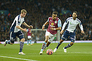 Scott Sinclair of Aston Villa goes past Chris Brunt of West Bromwich Albion (l) and Joleon Lescott of West Bromwich Albion (r). The FA cup, 6th round match, Aston Villa v West Bromwich Albion at Villa Park in Birmingham, Midlands on Saturday 7th March 2015<br /> pic by John Patrick Fletcher, Andrew Orchard sports photography.