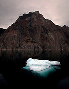 Glacier ice floating in Torssaukatak, Kujalleq, South Greenland, en route to Prins Christian Sund from the deck of the Greenpeace ship Arctic Sunrise during expedition to investigate the effects of climate change in the Arctic.<br />