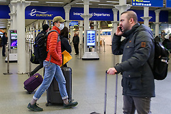 © Licensed to London News Pictures. 13/03/2020. London, UK. A man wearing a face mask at St Pancras International station. 798 cases have been tested positive and ten patients have died from the virus in the UK. Photo credit: Dinendra Haria/LNP
