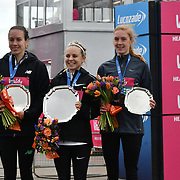 Steph Twell 3rd, Charlotte Purdue 1st and 3rd Charlotte Arter winner of the elite race at The Vitality Big Half 2019 on 10 March 2019, London, UK.