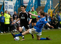 Photo: Glyn Thomas.<br />Chesterfield v Swansea City. Coca Cola League 1. 06/05/2006.<br />Swansea's Leon Britton (L) is tackled by Alan O'Hare.