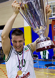 Jan Mocnik of Olimpija celebrates with a trophy after the basketball match between KK Union Olimpija Ljubljana and KK Krka Novo mesto in Final match of 11th Slovenian Spar Cup 2012, on February 19, 2012 in Sports hall Brezice,  Brezice, Slovenia. Union Olimpija defeated Krka 68-63 and became Slovenian Cup Champion 2012. (Photo By Vid Ponikvar / Sportida.com)