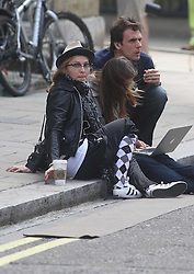 ©London News Pictures. 15/01/2011 .Picture Credit Should read Neil Hall/London News Pictures.Madonna directs her new period film W.E. starring Abbie Cornish about the abdication of King Edward in London on 08/08/2010. Madonna sits in the street between takes.
