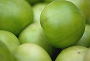 A selective focus, group of Green tomatoes on a table