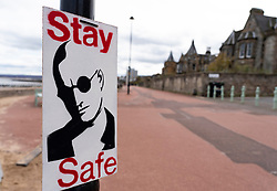 Portobello, Edinburgh. Scotland, UK. 11 April, 2020. On Easter weekend Saturday morning the public were outdoors exercising and walking on Portobello beach outside of Edinburgh. The popular beach and promenade was very quiet and people were exercising proper social distancing. Pictured; sign on lampost on the promenade. Iain Masterton/Alamy Live News