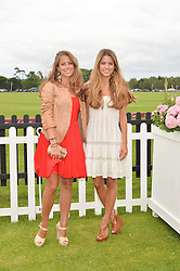 Left to right, sisters LYDIA FORTE and IRENE FORTE at the Cartier Queen's Cup Final polo held at Guards Polo Club, Smith's Lawn, Windsor Great Park, Egham, Surrey on 15th June 2014.