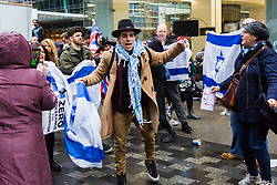 A young man sings and dances as Jews and supporters from across the UK demonstrate outside the headquarters of the Labour Party in Victoria Street, Westminster, against what they say is ongoing antisemitism within the Labour Party. London, April 08 2018.