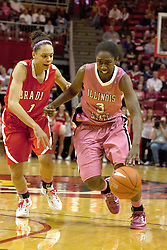 12 February 2012:  Candace Sykes works the offense against Michelle Young during an NCAA women's basketball game Where the Bradley Braves lost to the Illinois Sate Redbirds 82-63.  It was Play 4Kay day in honor of the cancer research fund set up by Coach Kay Yow at Redbird Arena in Normal IL