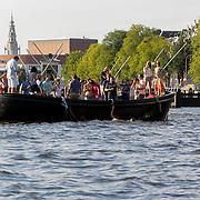 NLD/Amsterdam/20120812 - Varen door de Amsterdamse grachten, feestende jongeren op een boot