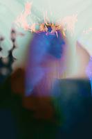 Blue feminine Christ like shadow figure with crown of fire.