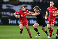 Paul Asquith of the Scarlets (l) and Jeff Hassler of the Ospreys. .Guinness Pro14 rugby match, Ospreys v Scarlets at the Liberty Stadium in Swansea, South Wales on Saturday 7th October 2017.<br /> pic by Andrew Orchard, Andrew Orchard sports photography.
