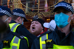 © Licensed to London News Pictures. 19/12/2020. London, UK. A protester is arrested on Regent Street. Protesters have gathered in central London for an anti-lockdown demonstration. Photo credit: Peter Manning/LNP