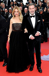 Kelly Preston and John Travolta attending the Solo: A Star Wars Story premiere at the 71st Cannes Film Festival