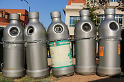 Plastic bottle recycling bins shaped like a bottle along Main Street at the Peace Center in downtown Greenville, South Carolina.