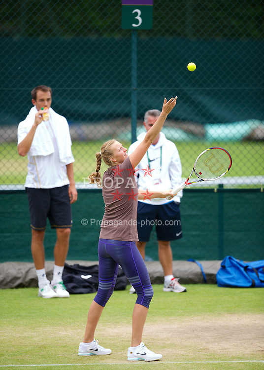 LONDON, ENGLAND - Friday, June 29, 2012: Lukas Rosol (CZE) watches as Petra Kvitova practices on day five of the Wimbledon Lawn Tennis Championships at the All England Lawn Tennis and Croquet Club. (Pic by David Rawcliffe/Propaganda)