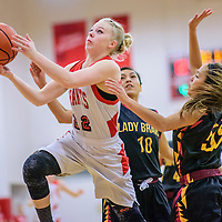 Grants Pirate Caylee Jones (22) attempts a shot on the  Santa Fe Indian Braves at the Grants Invitational girls basketball tournament at Grants High School Friday.